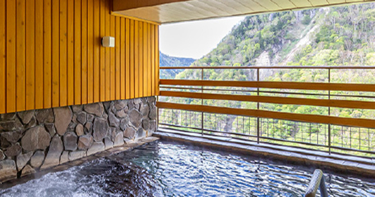 Japan SounkyoOnsen OnsenResortHotel HotelTaisetsu Grand public bath with a view